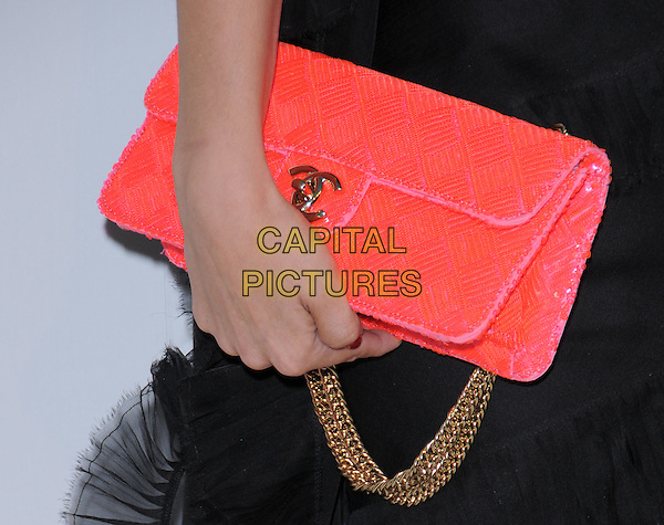 RACHEL BILSON's bag.at The Chanel Boutique Opening on Robertson Blvd. in Beverly Hills, California, USA, May 29 2008..detail Chanel red bag sequined beaded logo purse chain strap gold.CAP/DVS.©Debbie VanStory/Capital Pictures