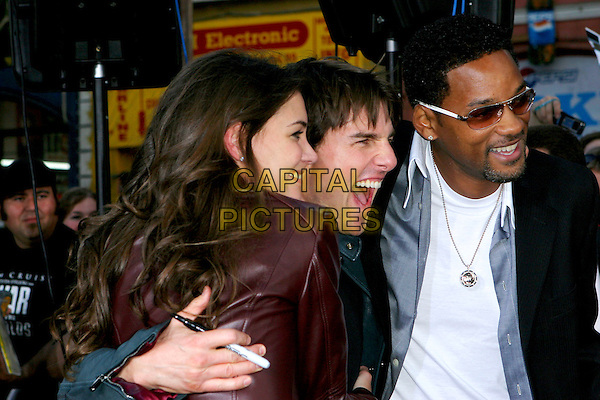 "KATIE HOLMES, TOM CRUISE & WILL SMITH .Arrive at  a Fan Screening of ""War Of the Worlds"" held at Grauman's Chinese Theatre, Hollywood, CA, USA,.27 June 2005..half length funny face hugging.Ref: ADM.www.capitalpictures.com.sales@capitalpictures.com.©Jacqui Wong/AdMedia/Capital Pictures."