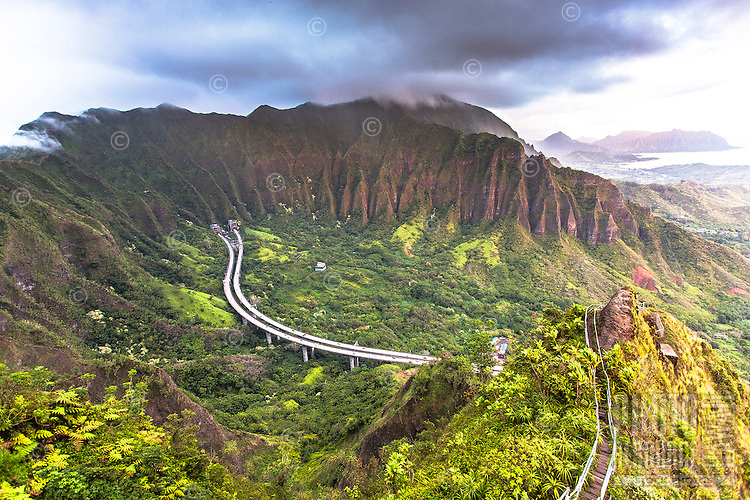 "An aerial view at dawn of the Ko'olau mountain range and H-3 Freeway from the Haiku Stairs (""Stairway to Heaven"") hiking trail in Kaneohe, O'ahu"