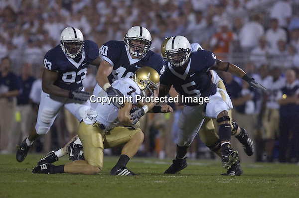 08 September 2007:  Penn State LB Dan Connor (40) sacks Notre Dame QB Jimmy Clausen (7) while Chris Baker (93) and Jerome Hayes (5) also close in.  Clausen was sacked 6 times in his first collegiate start.  The Penn State Nittany Lions defeated the Notre Dame Fighting Irish 31-10 September 8, 2007 at Beaver Stadium in State College, PA..