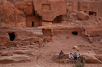 Tombs carved into the sandstone line the narrow canyon of Petra in Jordan.