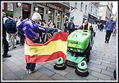 A Spanish fan practices his bull-fighting skills on a street-sweeping machine in Buchanan Street, Glasgow, in advance of the Champions League Final... Picture Donald MacLeod 15.5.02