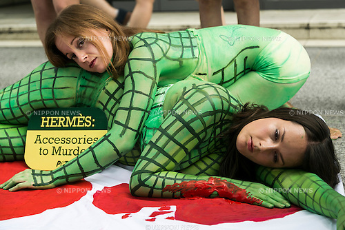 Body painted models from PETA (the People For The Ethical Treatment of Animals organization) pose as slaughtered crocodiles in front of the luxury Hermes store in the upscale Ginza shopping district on July 30th, 2015 in Tokyo, Japan. PETA claims that Hermes bags and accessories use crocodiles and alligators that are kept in poor conditions and still conscious when being cut open. Japan is a big market for Hermes and luxury brands with many Asian tourists and Japanese visiting Ginza for shopping. (Photo by Rodrigo Reyes Marin/AFLO)