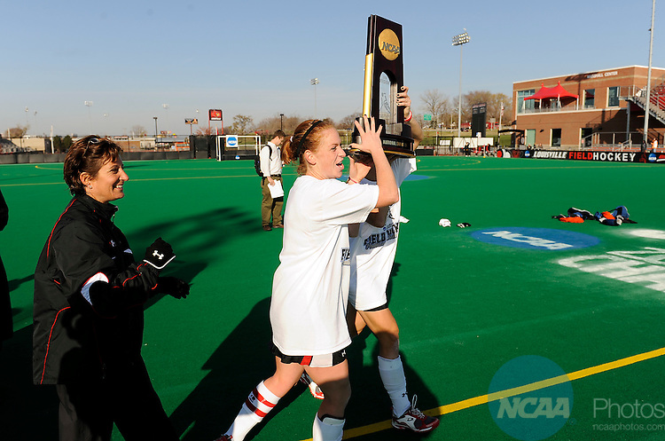 23 NOV 2008: Susie Rowe (6), Ellen Ott (15) and head coach Missy Meharg of the University of Maryland are presented with the National Championship Trophy after the Division I Women's Field Hockey Championship held at Trager Stadium on the University of Louisville campus in Louisville, KY.  Maryland defeated Wake Forest 4-2 for the national title. Greg Fiume/NCAA Photos