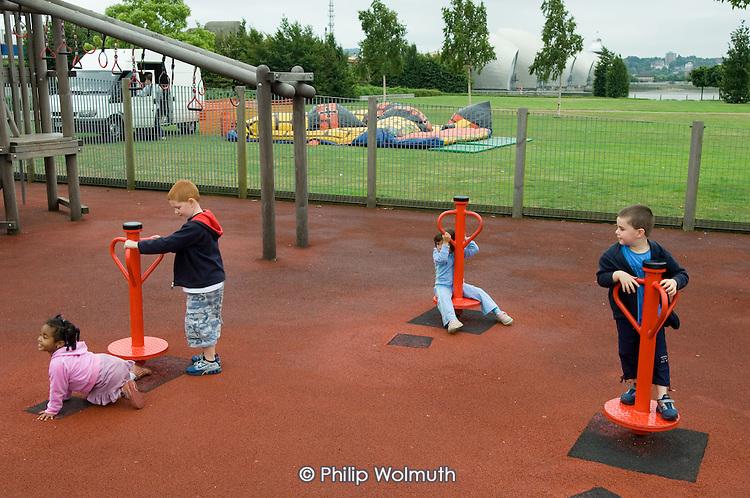 Children play in Thames Barrier Park, Newham, London.
