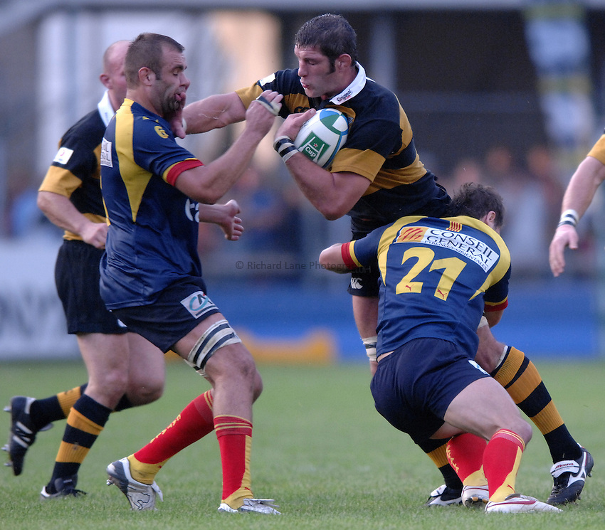 Photo: Richard Lane..Perpignan v London Wasps. Heineken Cup. 28/10/2006. .Wasps' Simon Shaw is tackled by Perpignan's Gregory Le Corvec and Nicolas Laharrague.