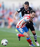 Atletico de Madrid's Juanfran Torres (l) and Granada's Nolito during La Liga match.April 14,2013. (ALTERPHOTOS/Acero)