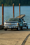 Chevy towing boat at boat dock.