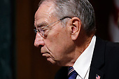 Senate Judiciary Committee Chairman Chuck Grassley (R-IA) listens during a confirmation hearing for U.S. Supreme Court nominee Brett Kavanaugh with Professor Christine Blasey Ford, who has accused Kavanaugh of a sexual assault in 1982, on Capitol Hill in Washington, U.S., September 27, 2018. REUTERS/Jim Bourg
