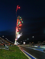 Jul. 19, 2013; Morrison, CO, USA: NHRA fireworks light up the night sky after the last pair of top fuel dragsters go down the track qualifying for the Mile High Nationals at Bandimere Speedway. Mandatory Credit: Mark J. Rebilas-