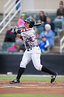 Everth Cabrera (39) of the Kannapolis Intimidators follows through on his swing against the Asheville Tourists at Kannapolis Intimidators Stadium on May 5, 2017 in Kannapolis, North Carolina.  The Tourists defeated the Intimidators 5-1.  (Brian Westerholt/Four Seam Images)