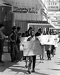 Picketers march along Main street of Prattville Ala. This and over 10,000 other images are part of the Jim Peppler Collection at The Alabama Department of Archives and History:  http://digital.archives.alabama.gov/cdm4/peppler.php