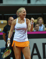 Arena Loire,  Trélazé,  France, 16 April, 2016, Semifinal FedCup, France-Netherlands, First match: Caroline Garcia of French vs Kiki Bertens (NED), Kiki Bertens (NED) takes the first set and jubilates<br /> Photo: Henk Koster/Tennisimages