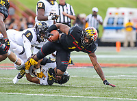 College Park, MD - September 9, 2017: Maryland Terrapins wide receiver D.J. Moore (1) tries to break a tackle during game between Towson and Maryland at  Capital One Field at Maryland Stadium in College Park, MD.  (Photo by Elliott Brown/Media Images International)