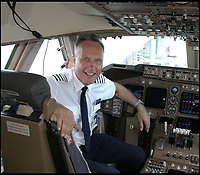 BNPS.co.uk (01202 558833)<br /> Pic: KarenGrimstead/BNPS<br /> <br /> Bob in the cockpit of his Boeing 747-400.<br /> <br /> My other planes a 747...!<br /> <br /> Former British Airways pilot Bob Grimstead(70) gets to grips with the worlds smallest twin jet aircraft.<br /> <br /> These remarkable photos capture the world's smallest twin-jet which resembles a 'bubble car on wings' taking to the skies.<br /> <br /> British pilot Bob Grimstead, 70, reached speeds of up to 140mph and climbed to 5,000ft in the Colomban Jet Cri-Cri.<br /> <br /> His wife Karen, 62, was in an aircraft next to him to take these snaps as he indulged in some aerial acrobatics, including several loops and rolls and a dramatic dive.<br /> <br /> The jet, which is almost entirely made of aluminium, is just 13ft long, 4ft wide and has a wingspan of 17ft, while weighing in at a paltry 180lb.<br /> <br /> Mr Grimstead, who lives in Sussex, has flown aircraft for 50 years and worked as a commercial pilot. He flew enormous Boeing 747s, which are at the complete opposite end of the size spectrum, weighing 400 tonnes when full of passengers and measuring 230ft in length, with a 210ft wingspan and a cabin width of 20ft.