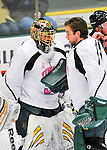 28 January 2012: University of Vermont Catamount starting goaltender Alex Vazzano, a Sophomore from Trumbull, CT, gets some encouraging words from his older brother John, prior to facing the Northeastern University Huskies at Gutterson Fieldhouse in Burlington, Vermont. The Catamounts, dressed in their Breast Cancer Awareness jerseys, fell to the Huskies 4-2 in the second game of their 2-game Hockey East weekend series. Mandatory Credit: Ed Wolfstein Photo