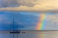 An early morning rainbow over the lagoon at Teahupoo, Tahiti, Sunday May 3 2009. Photo: joliphotos.com
