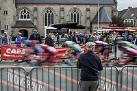 Peloton rolling through town. <br /> <br /> 103th Kampioenschap van Vlaanderen 2018 (UCI 1.1)<br /> Koolskamp &ndash; Koolskamp (186km)