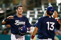 21 September 2012: Emmanuel Garcia is congratulated by Boris Marche during France vs South Africa tie game 2-2, rain delayed at the end of the 9th inning at 1 AM, during the 2012 World Baseball Classic Qualifier round, in Jupiter, Florida, USA. Game to resume 22 September 2012 at noon.