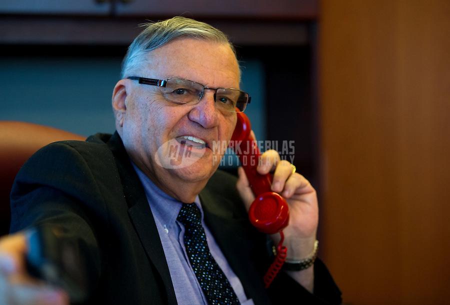 Jan 21, 2015; Phoenix, AZ, USA; Maricopa County sheriff Joe Arpaio talks on the telephone in his office in downtown Phoenix. Mandatory Credit: Mark J. Rebilas-