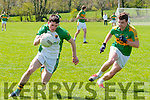 Ballydonoghue's Kieran Lynch wins  the ball  from Knocknagoshel's John Brosnan in their novice championship quarter final clash in Coolard on Sunday last.