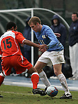 Carolina's Ben Hunter (11) takes on Virginia's Zola Short (15) on Sunday, November 27th, 2005 at Fetzer Field in Chapel Hill, North Carolina. The University of North Carolina Tarheels defeated the University of Virginia Cavaliers 2-1 in a NCAA Men's Soccer Tournament Round of 16 game.