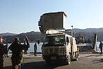 OSHIMA, Japan - Sailors with Amphibious Squadron 11 direct Japanese utility repair vehicles into a U.S. Navy landing craft at the dock here, March 27. The 31st Marine Expeditionary Unit and Amphibious Squadron 11 picked up the vehicles from the port here and delivered food, water, comfort items and the vehicles to residents on the isolated island of Oshima. The island of Oshima has been cut off from the mainland since the earthquake and tsunami March 11. U.S. Navy landing craft were used in the operation, demonstrating the expeditionary capabilities in ship-to-shore amphibious operations. Marines and Sailors of the 31st MEU are conducting humanitarian aid and disaster relief missions in northeast Japan assisting the Japanese Self Defense Forces in their ongoing operations. (Photo by USMC/AFLO) [0006]