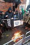 "© Joel Goodman - 07973 332324 - all rights reserved . 11/11/2010 . London , UK . MOHAMMED REZA HAQUE (aka "" Giant "") (3rd from left) . Muslims Against Crusades hold a demonstration and burn a poppy on the anniversary of Armistice Day , at Kensington Gore , opposed by a demonstration of nationalist groups including the English Defence League ( EDL ) . Photo credit : Joel Goodman"