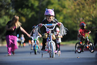 NWA Democrat-Gazette/ANDY SHUPE<br /> Jocelyn Louton, 4, rides her bicycle Wednesday, Sept. 23, 2015, during the first day of the annual First School Trike Rally at First United Presbyterian Church in Fayetteville. The event, which serves as a fundraiser for St. Jude's Children's Hospital, features bike riding, temporary tattoos, snow cones, a bike wash and demonstrations from the Fayetteville Police Department. Visit nwadg.com/photos to see more photographs from the morning.