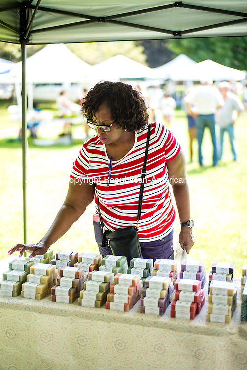 Southbury, CT- 20 July 2017-072017CM01-   Rosalind Payne Washington of Waterbury picks out items from Goatboy Soaps of New Milford during the weekly Southbury Farmers Market on Thursday.  The market which features locally grown and produced items, runs until October 12, 2017 on Thursdays from 3:00 pm to 6:00 pm.      Christopher Massa Republican-American
