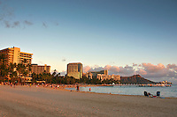 Sunset at Waikiki Beach with Diamond Head Crater in the distance, Honolulu, O'ahu.