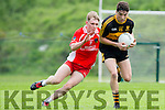 Cian O Murchu West Kerry gets ready to pounce on Tony Brosnan  Dr Crokes in action during  their SFCC clash in Lewis Road on Saturday