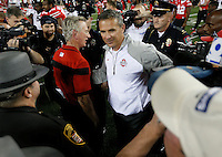 Ohio State Buckeyes head coach Urban Meyer, right, and Cincinnati Bearcats head coach Tommy Tuberville, left, shake hands after the college football game between the Ohio State Buckeyes and the Cincinnati Bearcats at Ohio Stadium in Columbus, Saturday afternoon, September 27, 2014. The Ohio State Buckeyes defeated the Cincinnati Bearcats 50 - 28. (The Columbus Dispatch / Eamon Queeney)