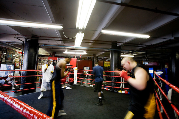 Team Animal, all training under Blimp for the 2006 Golden Gloves. Hitting the super heavy bag. They work in 2 minute rounds to train for the ring.. Gleason's Gym has continued its long standing tradition in the boxing world as a training ground of competitors by putting 5 fighters into the finals of the 2006 Golden Gloves amateur boxing competition.. An inside look at the last 10 days of training for the 5 young fighters.