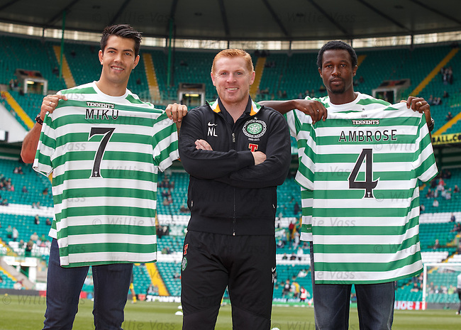 Neil Lennon with two new signings Miku and Ambrose before the match