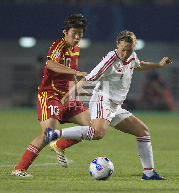 Denmark midfielder (7) Cathrine Paaske Sorensen and China forward (10) Ma Xiaoxu. The Peoples Republic of China (CHN) defeated Denmark (DEN) 3-2 during their FIFA Women's World Cup China 2007 opening round Group D match at Wuhan Sports Center Stadium in Wuhan, China on September 12, 2007.