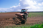 A0742W Red tractor ploughing a field in Suffolk Sandlings England