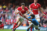 George North goes past Mirco Bergamasco..2012 RBS 6 Nations.Wales v Italy.Millennium Stadium..10.03.12.Credit: STEVE POPE-Sportingwales