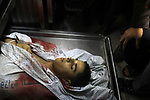 Relatives of 18-year-old Hamza Eshtewi, who was killed by Israeli troop in clashes at Gaza-Israel border, mourn over his body at the morgue of al-Shifa hospital in Gaza city, February 8, 2019. Two Palestinians were killed by Israeli fire on February 8 during clashes along the Gaza border, the health ministry in Hamas-run enclave said. Photo by Dawoud Abo Alkas