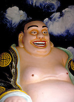 A fat Buddha statue in the Tiger Balm Garden of Hong Kong. In China and Hong Kong, fat is supposed to represent prosperity and good luck. Tiger Balm is an ointment much like Vicks VaporRub which, in Southeast Asia, is used for everything from arthrit is t