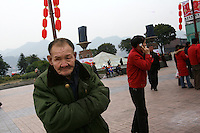 CHINA. Sichuan Province. Chongqing. A visually impaired man. Chongqing is a city of over 3,000,000 people, famed for being the capital of China between 1938 and 1946 during World War II. It is situated on the banks of the Yangtze river, China's longest river and the third longest in the world. Originating in Tibet, the river flows for 3,964 miles (6,380km) through central China into the East China Sea at Shanghai.  2008.
