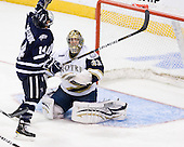 Mike Borisenok (UNH - 14), Mike Johnson (Notre Dame - 32) - The University of Notre Dame Fighting Irish defeated the University of New Hampshire Wildcats 2-1 in the NCAA Northeast Regional Final on Sunday, March 27, 2011, at Verizon Wireless Arena in Manchester, New Hampshire.