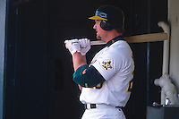 OAKLAND, CA - Mark McGwire of the Oakland Athletics waits in the dugout during a game against the Kansas City Royals at the Oakland Coliseum in Oakland, California in 1997. Photo by Brad Mangin