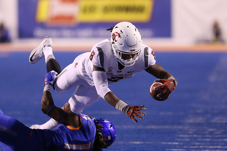 Tavares Martin Jr., Washington State University wide receiver, lunges for extra yardage during the Cougars non-conference road opener at Boise State on September 10, 2016.