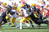 College Park, MD - October 15, 2016: Maryland Terrapins linebacker Antoine Brooks (25) makes a tackle during game between Minnesota and Maryland at  Capital One Field at Maryland Stadium in College Park, MD.  (Photo by Elliott Brown/Media Images International)