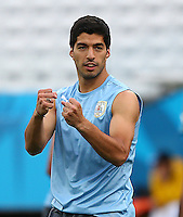 Luis Suarez of Uruguay pumps his fists as he trains in the Arena Corinthians, Sao Paulo ahead of his sides Group D crunch fixture vs England tomorrow