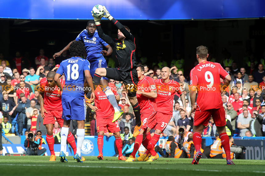Liverpool goalkeeper, Simon Mignolet, makes a fine  save to foil Chelsea's Kurt Zouma - Chelsea vs Liverpool - Barclays Premier League Football at Stamford Bridge, London - 10/05/15 - MANDATORY CREDIT: Paul Dennis/TGSPHOTO - Self billing applies where appropriate - contact@tgsphoto.co.uk - NO UNPAID USE