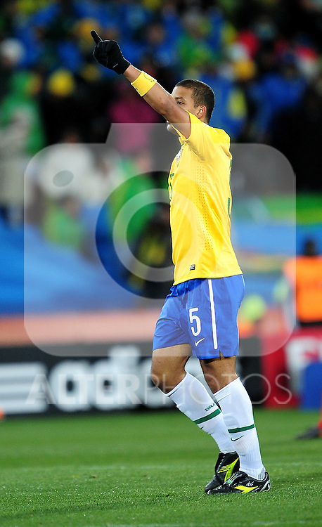 5 FELIPE MELO celebrates by pointing to heaven during the 2010 FIFA World Cup South Africa Group G match between Brazil and North Korea at Ellis Park Stadium on June 15, 2010 in Johannesburg, South Africa.