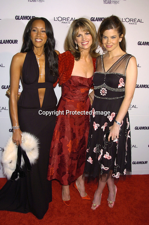 Cynthia Garrett, Lynn Koplitz and Jules Asner ..at The 15th Annual Glamour Magazine Women of the Year Awards on November 8, 2004 at The American Museum  of Natural History in New York City. ..Photo by Robin Platzer, Twin Images