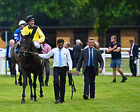Winner of The Bathwick Tyres Handicap, Koeman ridden by John Egan and trained by Mick Channon is led into the winners enclosure during Ladies Evening Racing at Salisbury Racecourse on 15th July 2017